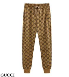 2019 cravate étiquettes en gros Nouveau printemps animaux femmes de style européen et américain pieds d'impression pantalon Slim casualGUCC