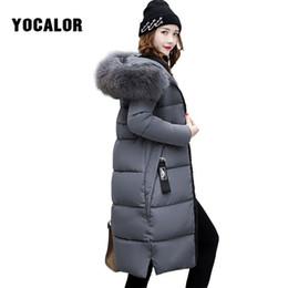 2019 snap pad 2018 abrigos de invierno mujer abrigo de cuello de piel chaqueta acolchada mujeres cálido Parka Feminina prendas de vestir exteriores pato tamaño más capucha desgaste de la nieve largo