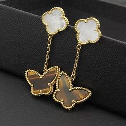 Boucles d'oreilles oeil de tigres en Ligne-Papillon oeil de tigre plaqué de cuivre exquise coquille blanche à quatre feuilles fleur double sort boucles d'oreilles trois couleurs