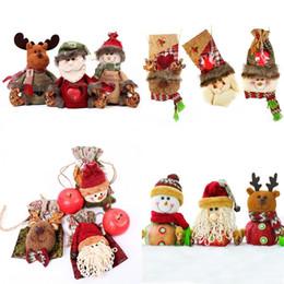 paquetes de dulces de santa Rebajas Paquete de Navidad de caramelo bolsa de tela Feliz Navidad de Apple Bolsa de Santa muñeco de nieve Elk paquete de regalo Bolsas decoraciones de Navidad