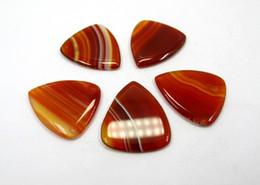 2020 dicas de guitarra Genuine Natural Carnelian Agat um e picareta da guitarra Cristal Pedra da picareta da guitarra,