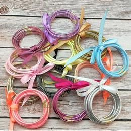 verão bracelete Desconto 5 pçs / set todo o tempo glitter bangles set glitter preenchido silicone bowknot de plástico de geléia verão pulseiras venda quente