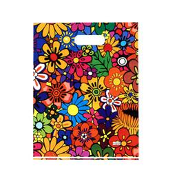 Chiari borse di regalo borse online-100PCS / LOT grandi piccoli sacchetti di acquisto di plastica stampati con la borsa di imballaggio del regalo dei vestiti della boutique della maniglia