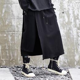 Nuevos hombres de moda causal de pierna ancha pantalón estilo japón negro falda  harem pantalones streetwear hip hop gótico suelto masculino kimono pant ... 05485cf97bd