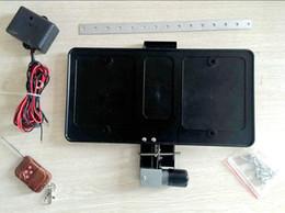 Telecomando auto targa online-2017 nuovo prodotto VISUALIZZA N GO targa patente telaio telecomando telecomando nascondi dimensioni USA copertura stealth piastra numero auto