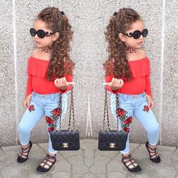Argentina Conjuntos de ropa para niñas de otoño Ropa para niños bebés Camiseta de manga larga roja + Vaqueros con estampado de rosas 2pcs Se adapta a ropa de niñas Suministro