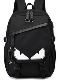 tendencias de la computadora Rebajas Luminosa hombres mochila mochila tendencia de la moda gran recorrido de la capacidad de ocio bolsa de ordenador USB mochila pequeño monstruo