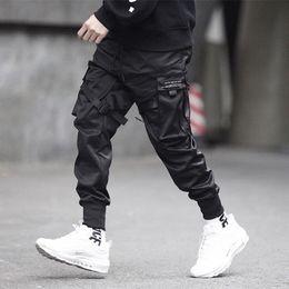 Uomini di pantaloni di svago online-Pantaloni lunghi hip-hop da uomo Pantaloni multi moda alla moda e casual Pantaloni alla moda pantaloni cargo hip-hop per il tempo libero