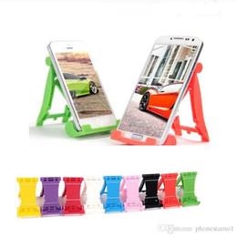 Toptan Cep Telefonu Tutucu Braketi Standı Mini Plastik kaymaz Şeker Renk Katlanır Tembel Destek Cep Telefonu Evrensel Braketi ... nereden