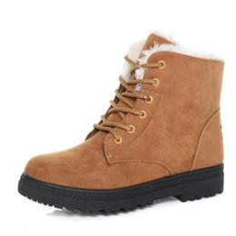 Botas cruzadas online-Nuevas botas para la nieve plana femenino versión coreana de zapatos de algodón Martin botas de invierno y el algodón botas de las mujeres de gran tamaño transfronteriza