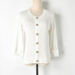 Остроконечный свитер онлайн-2019 spring and summer new small fragrance gold button seven-point sleeves curved  sweater round neck thin cardigan women