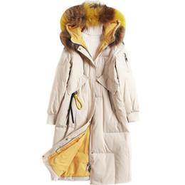 2018 Chaqueta de invierno para mujer Abrigo de piel de lujo Real Mapache de piel de mapache con capucha para mujer Abajo Chaquetas Forro cálido largo Parka desde fabricantes