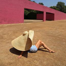 sombrero de vaquero de paja de papel Rebajas Cap mujer de Sun de la manera sombrero grande Playa anti-UV de protección solar plegable cubierta de paja de gran tamaño sombrilla plegable sombrero de paja de la playa
