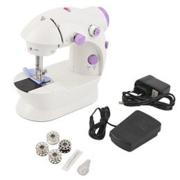 Nuevas máquinas de coser online-Mini escritorio de la máquina de coser eléctrica multifunción para el hogar con LED Nueva tienda mundial