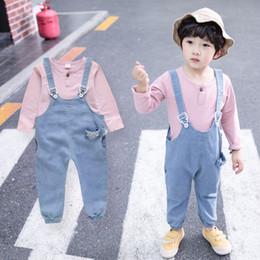 9281576ce5 Niños Niños Niñas Camiseta Cowboy Correas Pantalones 2 Unids   set  Primavera Verano Bebé Moda Ropa de algodón Conjuntos Niños Ocio chándal las  camisas ...