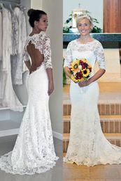 Vestido de noiva boêmio xl on-line-2019 vestidos de estilo de rua vestidos de noiva boêmio colher pescoço manga longa rendas praia boho jardim país vestidos de noiva robe de mariee