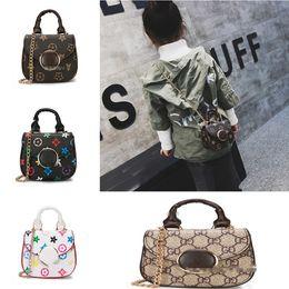 10a434a64f3 China Niños bolsos de diseño para bebés niñas mini princesa Pruses moda  patrón clásico diseño para
