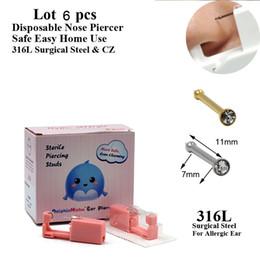 розовый пулемет Скидка 1 Box Pink Одноразовая Safe Стерильный пирсинг Раздел для носа Коты пирсинг пистолет для прокалывания станок комплект серьги стержня