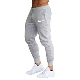 cravate étiquettes en gros Promotion 2019 hommes Haren Pantalons pour Casual Male Sweatpants Fitness hip hop entraînement Pantalons élastiques Vêtements pour hommes piste Joggers homme pantalons