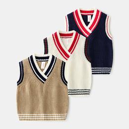 Chaleco de punto para niños online-Baby Boy ropa para niños suéter Chaleco con cuello en V Suéter de punto de color sólido Jersey 100% algodón Boutique Chica niño primavera suéter de otoño