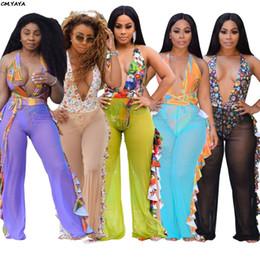 2019 nuove donne stampa ruffles lato splicing mesh vedere se gamba larga spiaggia pantaloni sexy club partito pantaloni lunghi 5 colori SJ3266 da pantaloni di tela gialla donne fornitori