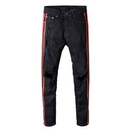 Дизайнерские черные комбинезоны онлайн-Мужской стиль DistressedKANYE Джастин Бибер Мужские джинсы Рваные джинсы Модельер BlACK Star Мужские комбинезоны Джинсовые мужские брюки ТОП