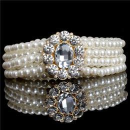Venta al por mayor al por mayor nueva moda pequeña hebilla de oro incrustación rhinestone perla elástica correa de las mujeres correa de envío gratis desde fabricantes