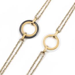 Le donne tengono il braccialetto Cerchio nero Ceramica Fascino con il colore dell'oro L'acciaio inossidabile regalo di moda per le donne Accessori Gioielli moderni da