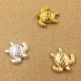 50 unids 14 * 15mm oro plata tortuga turtoise encantos del grano colgantes de metal aleación DIY accesorios de la joyería Headwear pelo Material de la artesanía desde fabricantes
