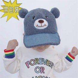 cordbär Rabatt Kindermützen ins Bärenohren Glocken Kappen Karikatur Kord Babymützen Lammfell warme Hüte drücken Sie die Nase zu machen haben einen Sound