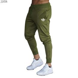 Collants en coton imprimé en Ligne-Pantalons pour hommes d'automne fitness coton pantalons pour hommes mode casual pantalons serrés impression de cordon pour hommes taille stretch