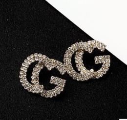 2019 Nuovi orecchini di nappa con strass pieno firmati per le donne Regali di gioielli per orecchini a bottone in oro e argento520 da