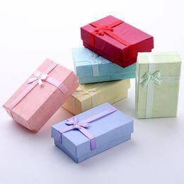 Roter schwarzer armbandring online-Schwarz blau rosa rot grün 5 * 8 * 2,5 cm mode für charme perlen geschenkbox verpackung für anhänger halsketten ohrringe ringe armbänder schmuck