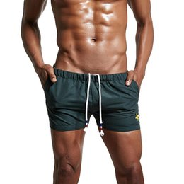 f17ec78b26 2019 New Fashion Quick Dry Clothing Men's Casual Shorts Household Man Shorts  With Pocket Sport men's Board Swimwear
