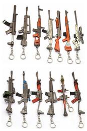 Argentina Juego Pistola Fortnite Llavero Accesorios Modles Fusil de Combate Rifle Llavero Anillo de Metal Hombres Coche Mujeres Bolsa Joyería Suministro