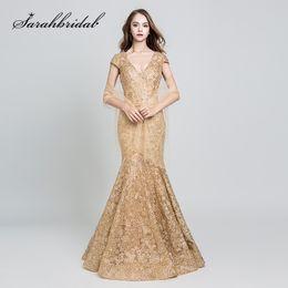 2019 Elegante Abendkleider Lange Goldspitzenstickerei Sexy V-Ausschnitt Backless Kurzen Ärmeln Meerjungfrau Mutter der Braut Formelle Kleider 547 von Fabrikanten