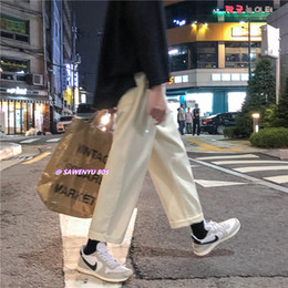 Pantalones holgados blancos para hombre online-2019 Hombre Ocio Baggy Homme Pantalones casuales Pantalones vaqueros clásicos Pantalones para hombre Color negro / blanco Pantalones anchos para hombre Tamaño grande S-2XL