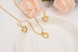 Pingente de corrente de ouro sólido on-line-Dubai India Ethiopian Solid Gold GF amor Hollow heart set Jewelrysets mulheres Cadeia Pingente Brincos Africano Noiva Casamento Bijoux