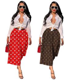 Seulement les robes des femmes en Ligne-Les femmes marque tomber jupes midi de sexy casual pli imprimer des vêtements de mode automne d'été lâche robes jupes vente (seulement jupes) DHL 1073