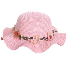 Fiore ondulato online-Wholsale Summer Children donna fiore Simple Ondulato grande cappello di paglia a tesa larga ragazzi ragazze Beach Hats cappello da sole genitore-figlio