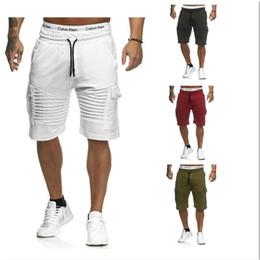 5 доступных цветов Мужские мульти-карманные брюки-карго эластичный пояс хип-хоп сплошной цвет случайные спортивные шорты cheap short pants multi pocket от Поставщики короткие брюки с несколькими карманами