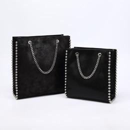 Большая бортовая цепь онлайн-Большая емкость большая сумка женская мода цепочка заклепки сумки на ремне леди коммутирующих Pu кожаные кошельки сумки сплошной цвет сумка из бисера