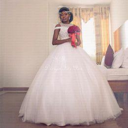 fotos vestidos bolero Desconto Contas vestido de baile africano vestidos de casamento 2019 jóia varrer trem capela jardim país vestidos de noiva plus size vestidos de novia