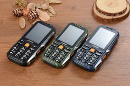 Недорогой мобильный английский онлайн-Дешевые GSM ультра-тонкий военная промышленность три анти-прямой совет сенсорный экран рукописный мобильный ультра-длинный резервный телефон английский Россия