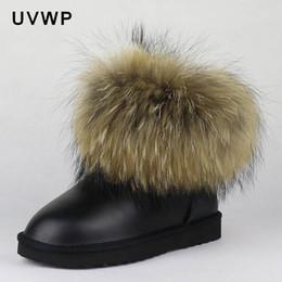 2019 pelle di procione Top Fashion Natural Big Fox Fur Gneuine Leather Snow Boots da donna Warm Winter Boots Slip-On Ankle Female Raccoon Fur pelle di procione economici