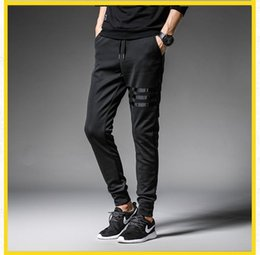 Lápices de cigarrillos online-Three Line Sports Pants Spring and Autumn Hot Sale Pencil Pants Hombre Casual Drainy Pipe Jeans Daliy Cigarette Pants LARGE tamaño M-5XL