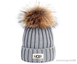 2019 оптовые шляпы индейки Роскошные женщины зима бренда мужчины Beanie Модельеры Bonnet женщин вскользь вязание хип-хоп Gorros помпонами черепа шапки шляпы на открытом воздухе