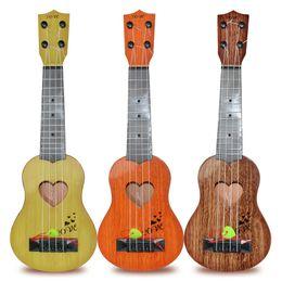 Argentina Simulación Ukelele Principiante Jugable Hombres y mujeres Guitarra Instrumento musical Instrumentos para niños Juguetes Regalo Orden de prueba 5 5dh M1 E1 cheap order guitars Suministro