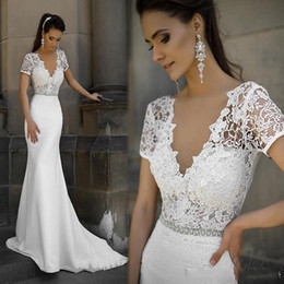 dentelle robes blanches transparentes Promotion 2020 Milla Nova Crystal Short Sleeve Deep V Neck Mermaid Bridal Gowns Backless White Beads Lace Transparent Wedding Dresses Custom Made
