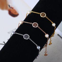 men s gold onyx bracelets Скидка Новая фирменная T письмо Дизайнер Фирменная женщина Эмаль жемчуг роскошный алмаз Лаки T Hollow Письмо браслет Shell Письмо подарок браслет